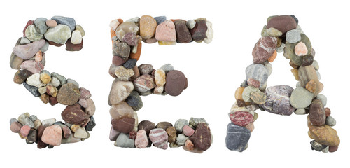 SEA word with beach pebbles