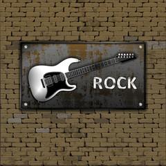 Music design. Old brick wall rusty metal sheet iron guitars and rock inscription.