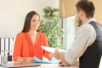 Woman giving resume in a job interview