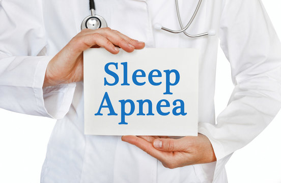Sleep Apnea card in hands of Medical Doctor