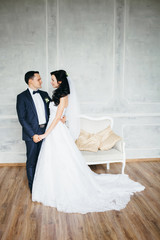 Wedding photo shoot of the newlyweds in a beautiful Studio inter