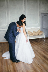 Wedding photo shoot of the newlyweds in a beautiful Studio inter