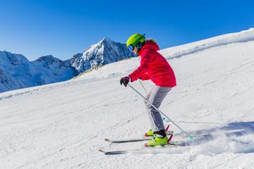 Teenage girl skiing in mountain ski piste track in Solda/Sulden,