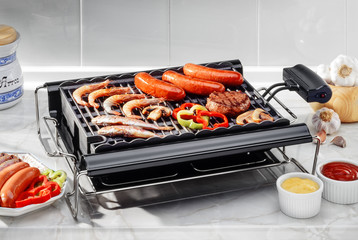 Photo on textile frame Grill / Barbecue electric barbecue with fish and meat