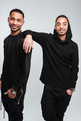 Two happy attractive african american young men in black clothes
