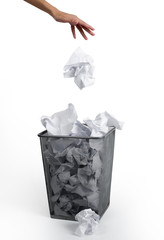 Woman hand putting paper in a bin, on white background.