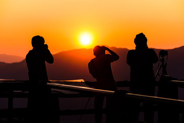 Silhouette of photographer, taking pictures of the beautiful moments during the sunset ,sunrise.