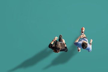 Top view of fitness female and male running