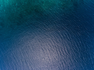 Wall Mural - Blue sea surface aerial view