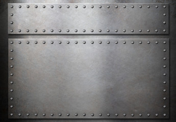 two steel plates with rivets over metal background