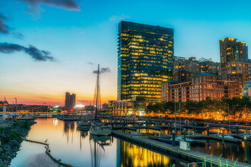 Baltimore, USA. Harbor and street view at sunset and deep colored sky. Splittoned, vivid image