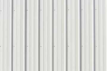 Light gray metal siding with shadows