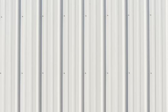 Light gray metal siding with shadows