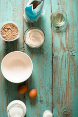 Ingredients for pancakes gluten free on the  blue wooden table vertical