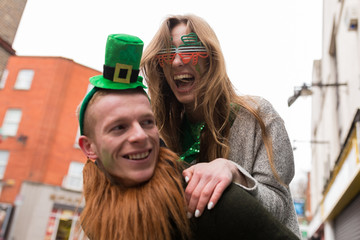 Smiling Young Couple Having Fun During St Patrick's Day in Dubli