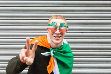 Young Irish Man Doing Victory for St Patrick's Day Dublin Irelan