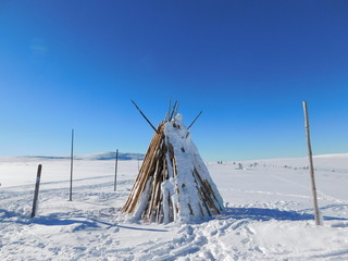 Wigwam on the covered with snow lowland