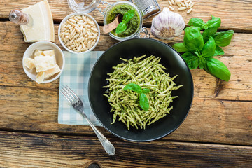 Trofie pasta with vegetarian sauce, pesto with pine nuts and bas