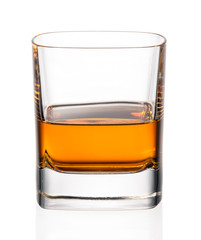 Fototapete - Glass of whiskey on a white background