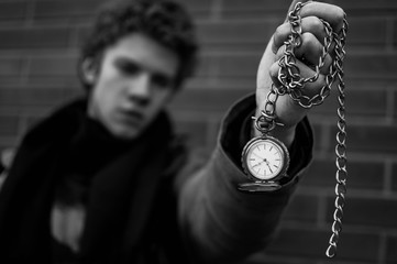 Holding time old watches black and white
