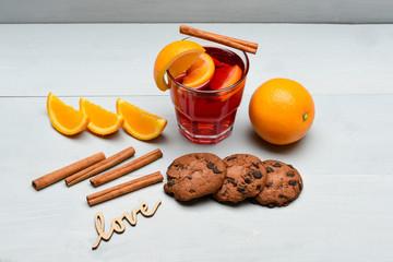 tea or mulled wine with cinnamon, orange and chocolate cookies