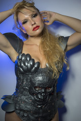 Valkyrie, beautiful blond woman with long hair. She wears a silv