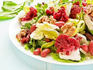 Salad with walnuts and various herbs