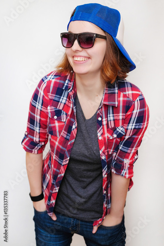 2fafbd740d7 Hipster girl with hair in a red plaid shirt