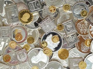 medaillen und münzen aus gold und silber hintergrund