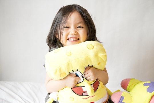 Asian girl holding spongebob