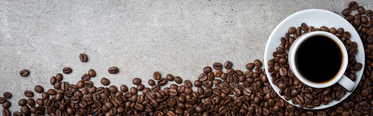 Poster de jardin Café en grains Cup of coffee with coffee beans on gray stone background. Top view