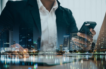 Double exposure of businessman  holding smartphone and touching
