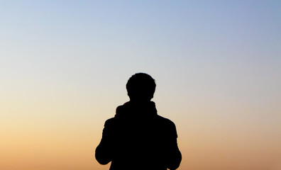 guy silhouette against twilight