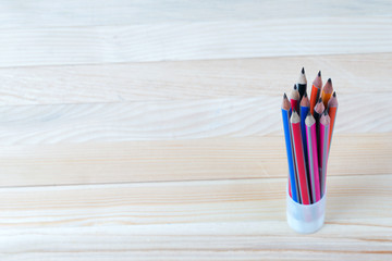 Pencils on a wooden table. Back to school