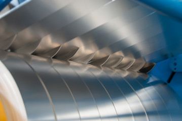Sheet metal strips exiting the slitting line