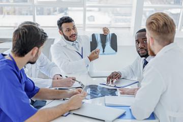 Clever medical team diagnosing human illness
