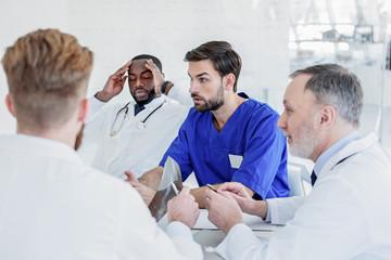 Smart doctors talking about patient health