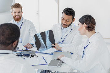Professional general practitioners discussing radiograph