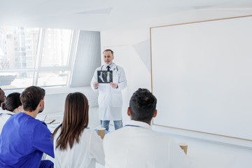 Experienced general practitioner explaining medical issues