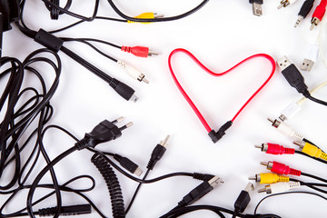 heart of wires surrounded by a frame background audio cables