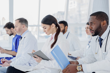 Skillful doctors listening to medical report