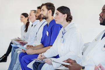 Serious doctors diagnosing human illness