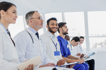 Professional doctors making notes with interest
