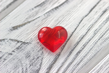 Red Heart on the gray painted wooden background