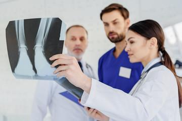 Skillful doctors analyzing x-ray photo