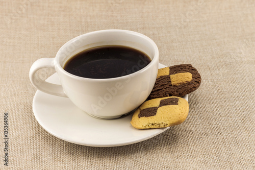 Cup Of Coffee With Biscuit Chess Like Cookies On Burlap