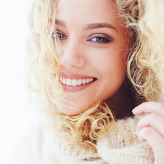 portrait of beautiful happy woman with curly hair and adorable smile
