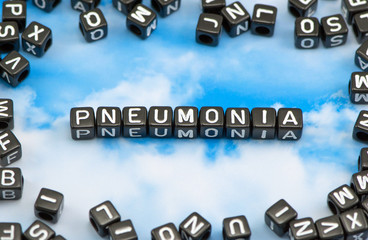 The word pneumonia on the sky background