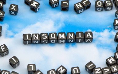 The word Insomnia on the sky background
