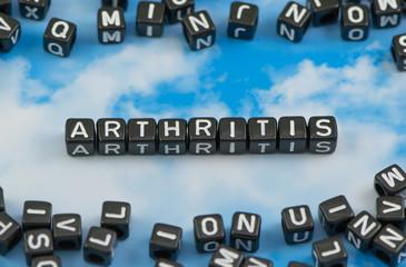 The word arthritis on the sky background